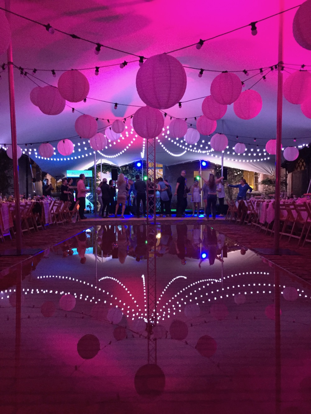 A stretch marquee with festoon lighting and pink up-lighting