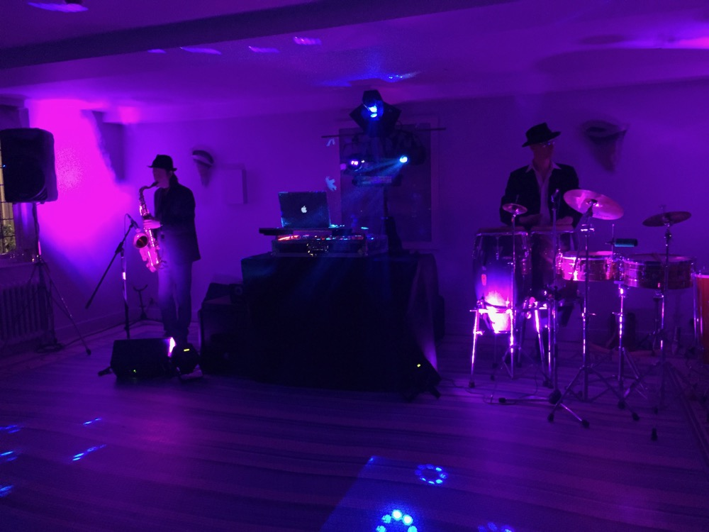 Add a live aspect to a standard DJ setup with Sax and Bongos.