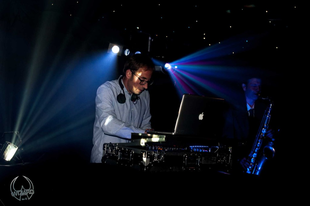 Picture of a DJ playing with a Sax and Bongo Player