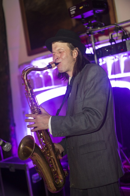 Image of a Sax player blowing hard