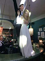 Image of a bride & groom dancing on a bar