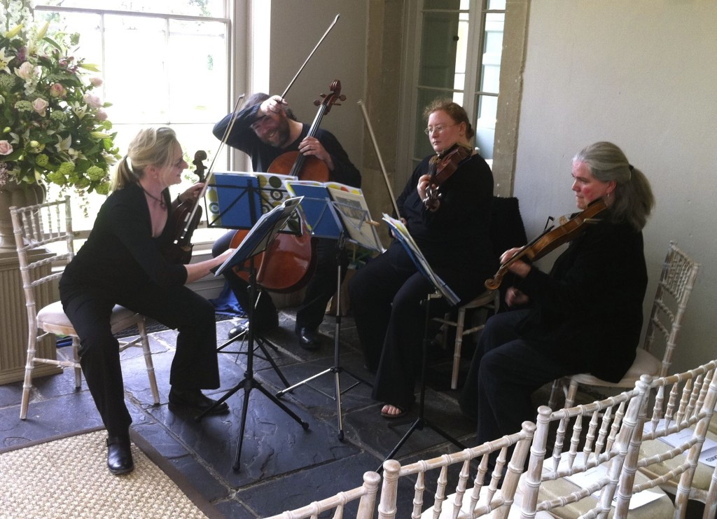 Image of string quartet rehearsing