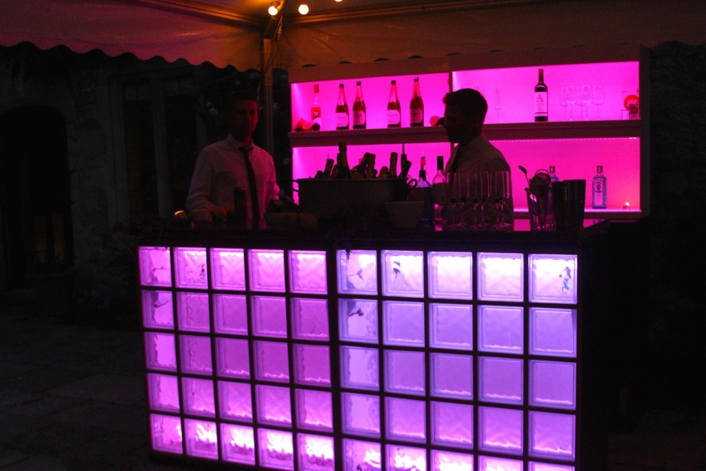 Image of cocktail bar and barmen at private party.