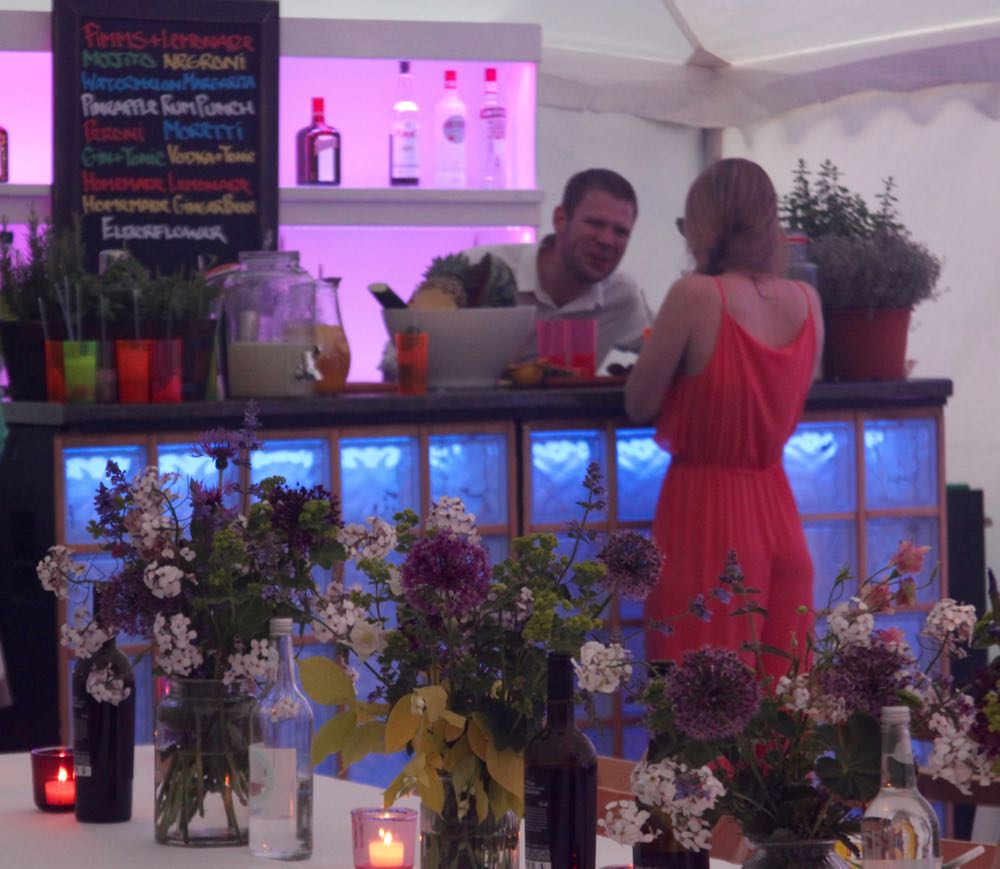 Image of a marquee party with a cocktail bar