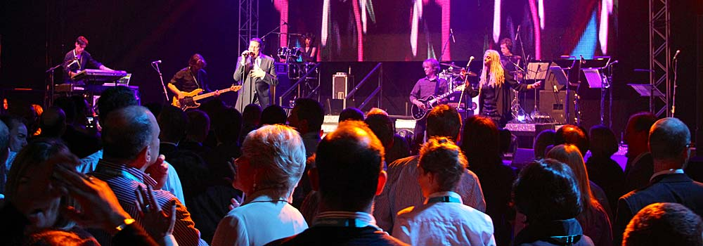 Image of a large stage with live band