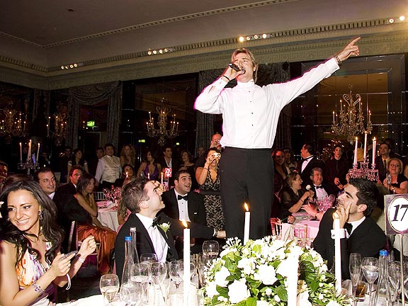 Image of the singing waiters performing