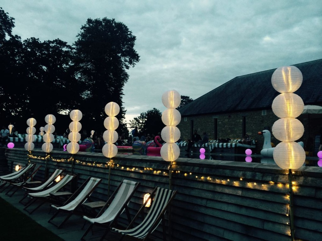 Image of Babington House Swimming Pool with party lighting installed around the edge.