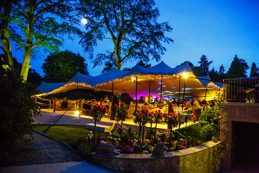 outdoor party lighting with marquee