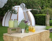 Image a garden with chill out dome, lighting and beautiful drinks ready for a drinks reception.