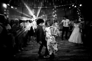 Tipi Wedding with Mother and son dancing.