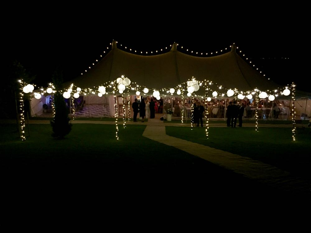 Canvas Marquee at night with exterior lighting canopy