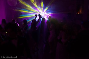 Image of a dark ballroom with dj lighting