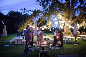 Image of a group of people with festoon wedding lighting