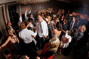 Image of a small, full dance-floor with happy people