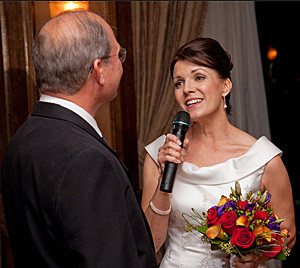 Image of a bride holding a microphone