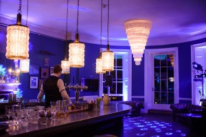 Babington House Bar with mood lighting and DJ lighting.