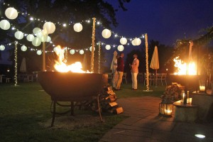 lighting canopy with festoon lighting, fairy-lighting with fire-pits close by.