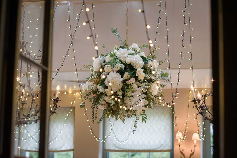 Image of a largw flower ball surrounded by fairy-lights