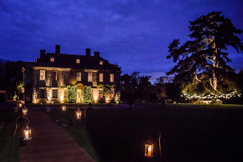 Shot from the church at Babington House, image of bushes and tree lighting.