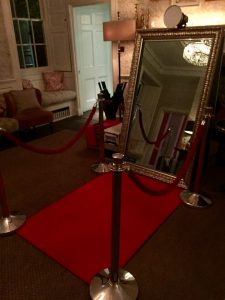 magic mirror photo booth with red carpet ropes and poles
